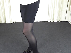 Shemale in black pantyhose & tight skirt
