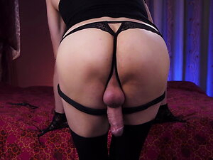 Horny ladyboy stroking cock in black lingerie and cum on clo