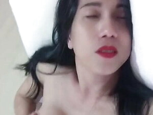 asian trans anairb doing strip tease and play her huge boobs