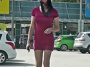 Crossdresser Sissy wears red mini dress in public