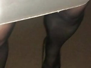 Kirsty walking in tight nylon skirt.