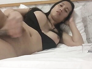 asian shemale stokes her 7 inch cut cock in her hotel bed