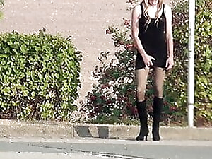 Crossdresser Sissy goes outside in minidress and boots